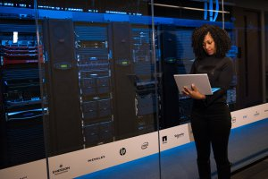 woman working at website hosting servers
